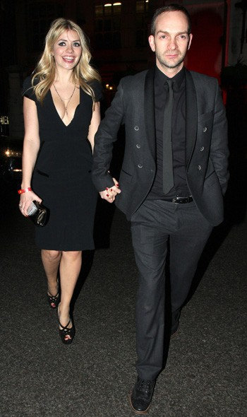Holly Willoughby and husband Dan arriving at the Warner Music party