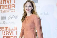 Hot or not: Angelina Jolie's split orange dress