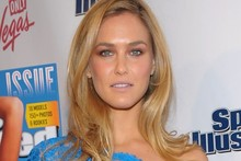 Bar Refaeli wears neon blue lace mini dress to Sports Illustrated bash