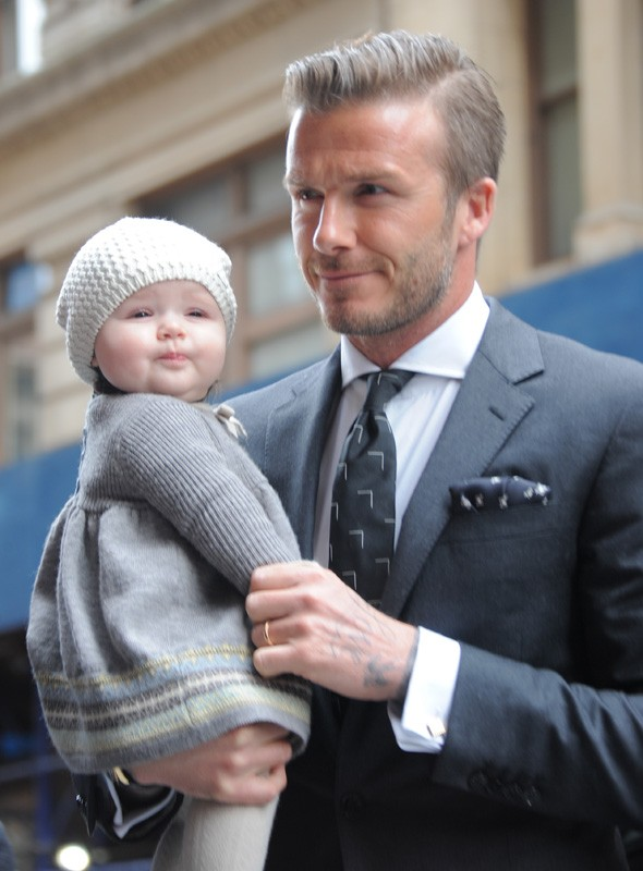 David and Harper Beckham arrive at Victoria Beckham's Autumn/Winter 2012 show during New York Fashion Week