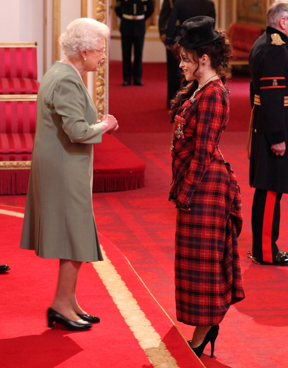 Helena Bonham Carter collects CBE in tartan two-piece