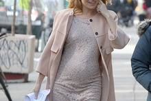 Sienna Miller shows off baby bump on-set in New York