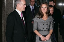 Duchess Kate flies solo in grey coat dress at Freud exhibition opening