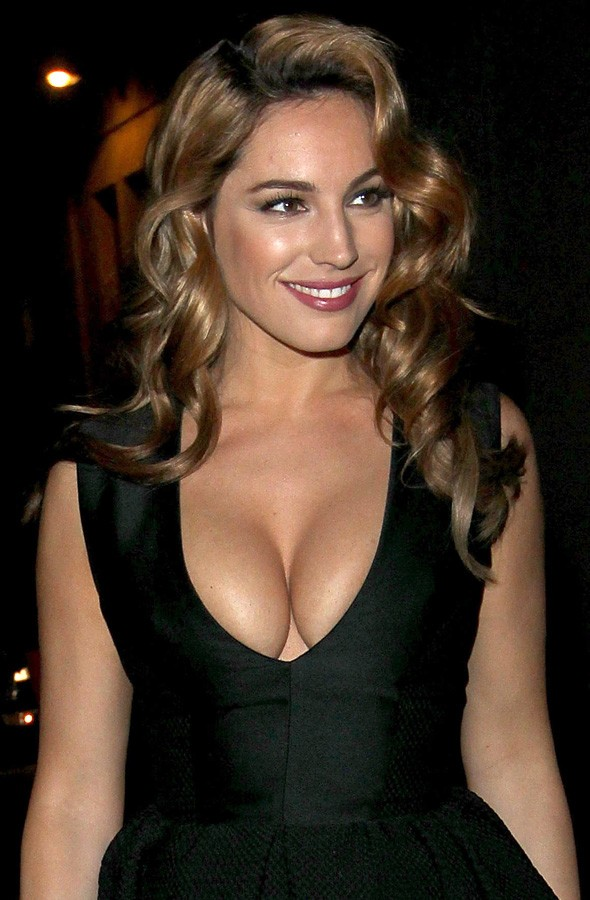 Kelly Brook arriving at the Giles show in plunging black prom dress. Photo:Getty