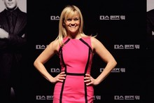 Reese Witherspoon pops in neon pink at This Means War press conference