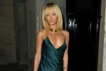 Rihanna does the splits! Singer dares to bare in stunning teal dress