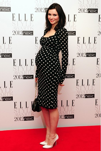 Sophie Ellis-Bextor shows off her bump in a polka-dot frock