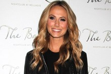 What would George say? Stacy Keibler wears micro-mini LBD in Vegas