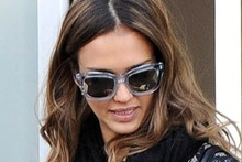 Jessica Alba gets leggy in leather mini skirt