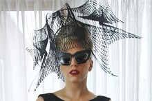 Lady Gaga heads to Harvard in glam black dress and huge net headpiece