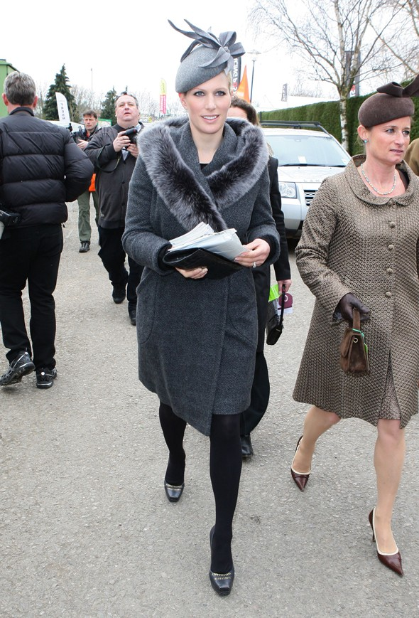 Grey day: Zara Phillips wraps up warm in hat and coat for trip to Cheltenham Festival