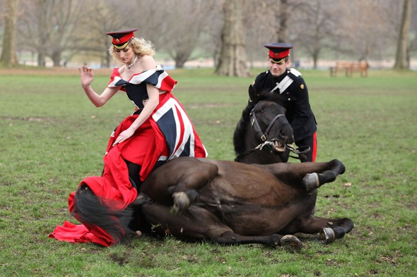 Horsing around: Model Jade Parfitt's equine partner pauses for a mud roll during glam shoot
