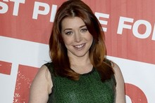 Alyson Hannigan shows off baby bump in glittering green mini dress