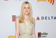 Dakota Fanning is all aswirl on the GLAAD red carpet