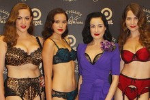 Dita Von Teese shows off her bra at lingerie launch