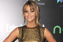 Golden Girl: Jennifer Lawrence dazzles at The Hunger Games premiere