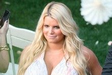 Heavily-pregnant Jessica Simpson plays the blooming bridesmaid at friend's wedding