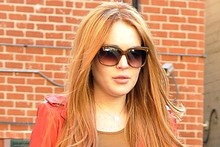 FINALLY! Lindsay Lohan ditches the blonde and embraces her inner redhead again