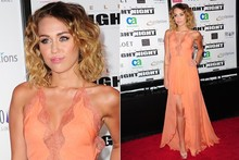 Miley Cyrus shows off curled crop on Fight Night red carpet
