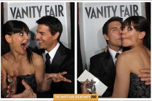 Say cheese! Katie Holmes and Tom Cruise are snap happy in Oscars photo booth