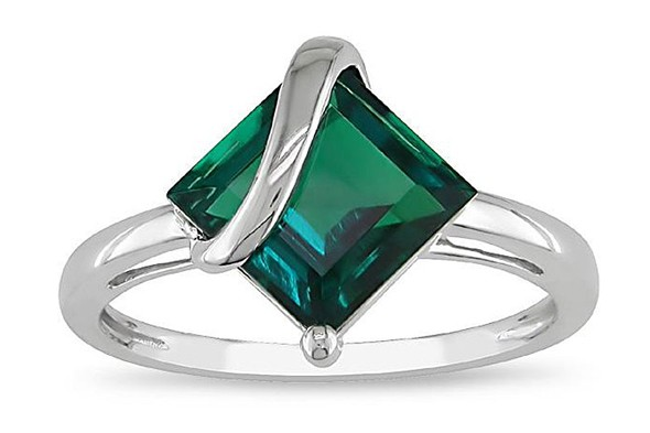 White gold created emerald ring