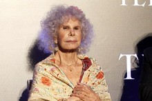 The Duchess of Alba dons red fishnets to pick up Telva award