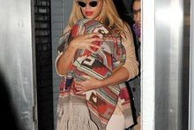Beyonce rocks cat-eye specs and new blonde hairstyle on outing with Blue Ivy