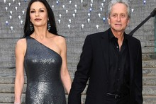 Party girl: Catherine Zeta-Jones sparkles for night out with Michael Douglas