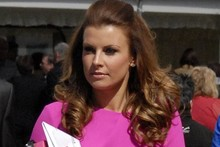 Hot or not: Coleen Rooney wears neon pink to the races