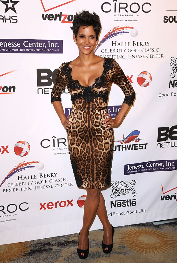 Wild thing: Halle Berry rocks skintight jungle print to Beverly Hills gala