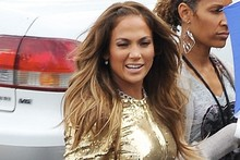 Jennifer Lopez does her best Oscars statue impression in top-to-toe gold