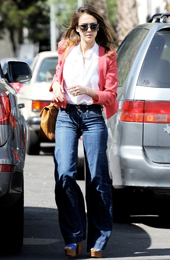 A flare for style: Jessica Alba's wide-legged jeans and HUGE platforms