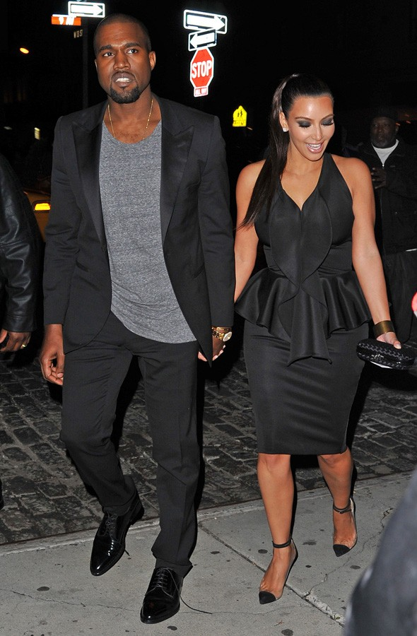 Kanye West and Kim Kardashian hold hands