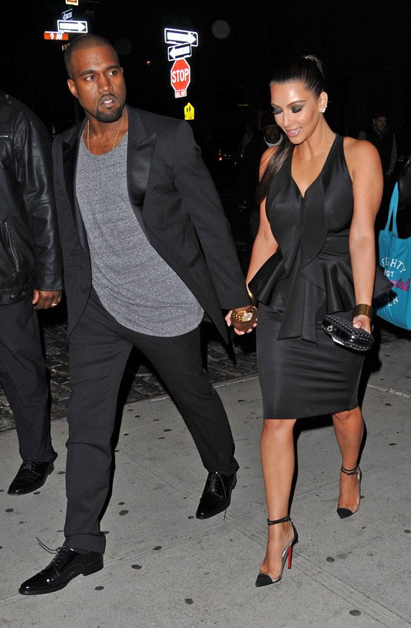 Kanye West and Kim Kardashian holding hands