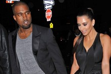 It must be love: Kim Kardashian and Kanye West HOLD HANDS