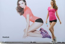 Miranda Kerr strikes a pose in front of Miranda Kerr. Wait, what?