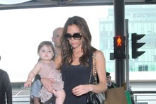 Victoria Beckham jets out of Hong Kong, Harper looks cuter than ever