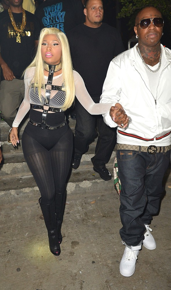 Bondage harness + string vest = Nicki Minaj's most insane ensemble to date?