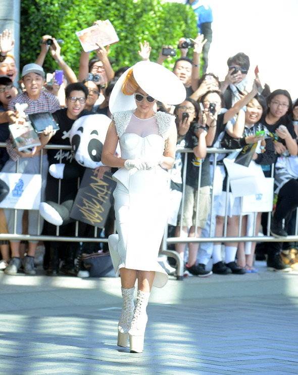 Under the radar? Lady Gaga keepin' it real in circular headgear
