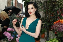 Dita Von Teese takes the plunge at perfume launch