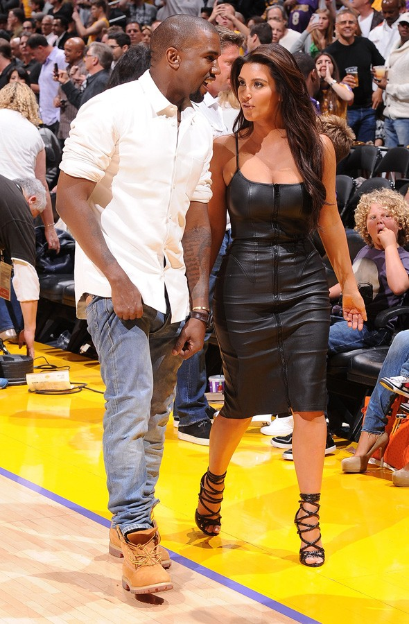 Kim Kardashian and Kanye West at a basketball game