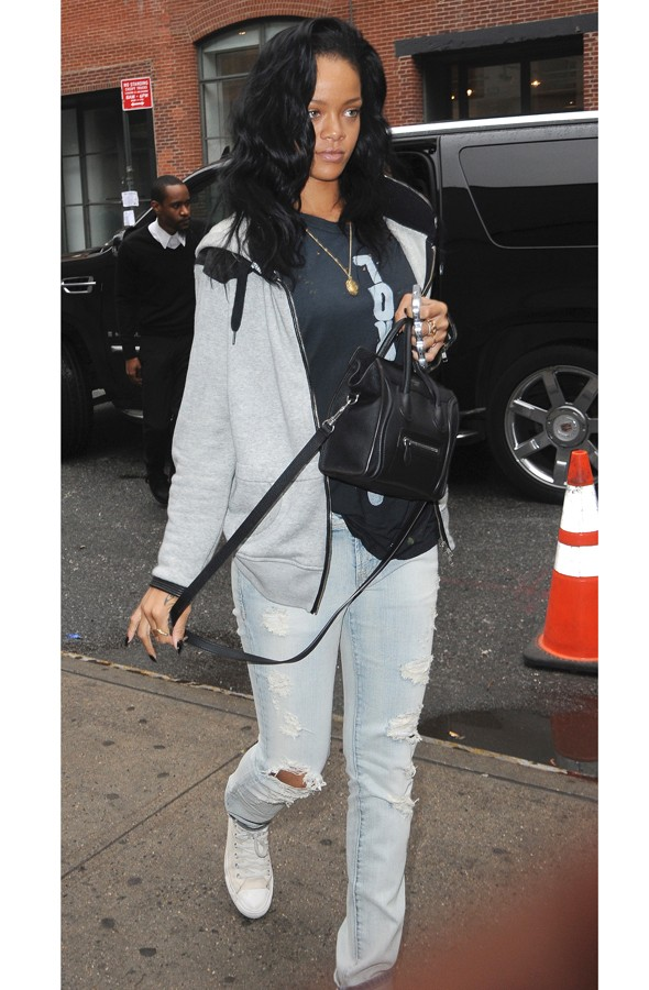 Street Style Rihanna Dresses Down In Ripped Jeans And A