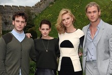Kristen Stewart and Charlize Theron head to a castle for Snow White photo call