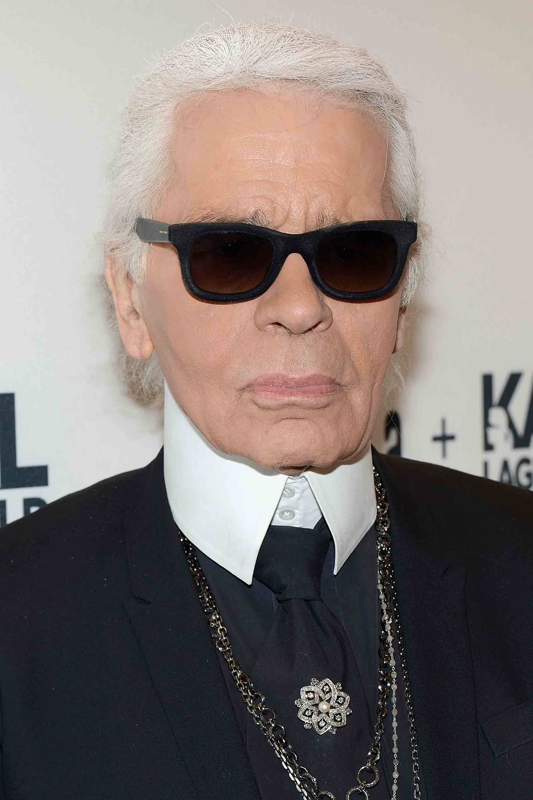 karl lagerfeld In terms of cultivating an image, karl lagerfeld may just be the master at the mere mention of the designer, who helms chanel and fendi, as well as his own namesake labels, his powder white ponytail, iconic black sunglasses, and quilted motorcycle gloves spring instantly to mind having long since.