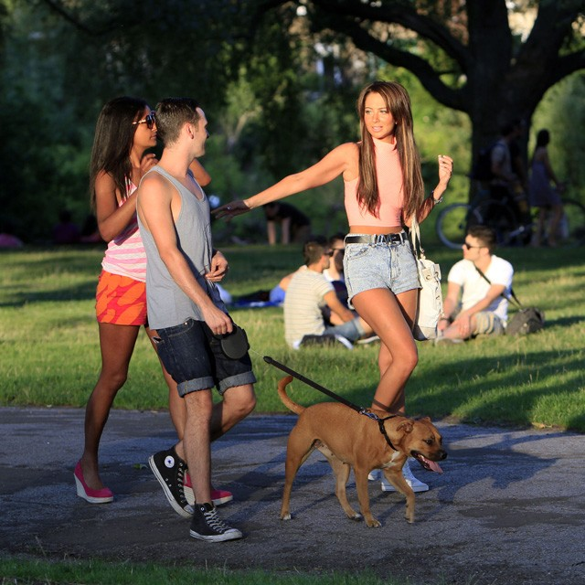 tulisa walks dog in the park with friends