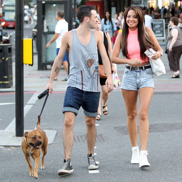 tulisa walks her dog with a friend in london