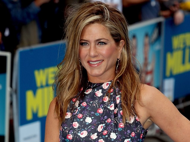 Jennifer Aniston Shows Off New Style (And HUGE Rock) At We're The Millers European Premiere