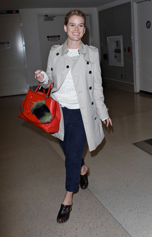 Alice Eve's Airport Chic Proves You Can Never Go Wrong With A Classic Mac