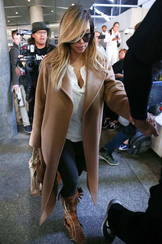 KIm Kardashian Ditches The Ricardo Tisci Styling For Flight Out Of Paris