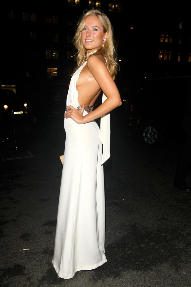 Kimberley Garner Shows Off Side Boob In Revealing White Jumpsuit
